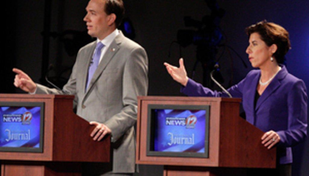 Clay Pell and Gina Raimondo during the Aug. 26, 2014, Providence Journal - WPRI-TV Democratic gubernatorial debate. Credit: The Providence Journal / Kris Craig