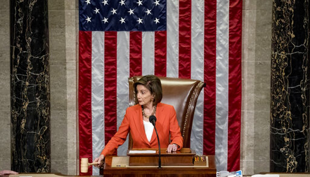 House Speaker Nancy Pelosi of Calif. gavels as the House votes 232-196 to pass resolution on impeachment procedure. (AP Photo/Andrew Harnik)