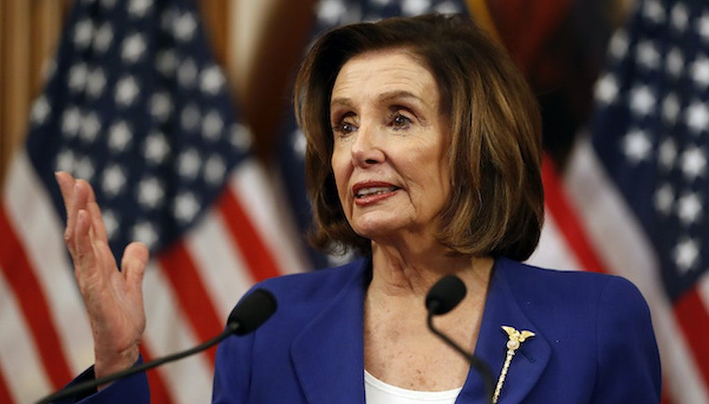 House Speaker Nancy Pelosi of Calif. speaks before she signs the Coronavirus Aid, Relief, and Economic Security (CARES) Act. (Associated Press)