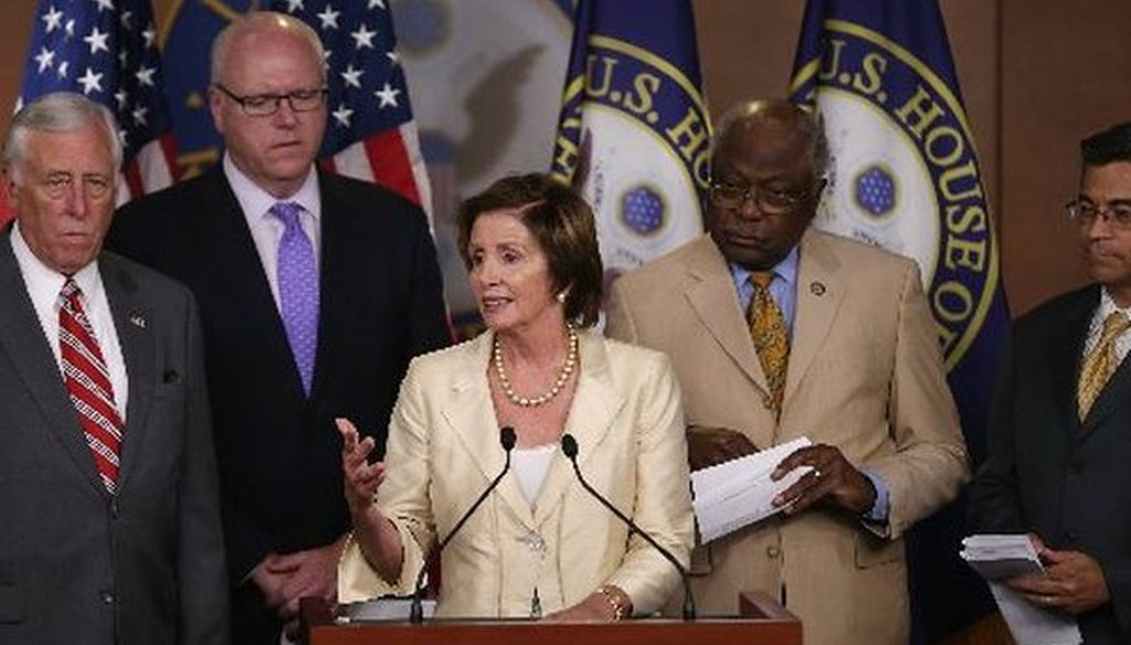 House Minority Leader Nancy Pelosi, D-Calif., joins fellow Democratic leaders in condemning a party-line vote by the House to authorize a lawsuit against President Barack Obama on July 30, 2014.