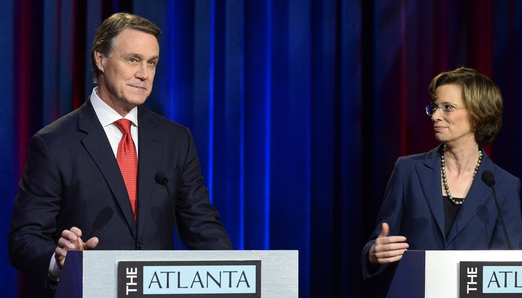 U.S. Senate hopefuls Republican David Perdue and Democrat Michelle Nunn focused mainly on two key talking points during their Atlanta Press Club debate on Oct. 26. David Tulis/ for the AJC