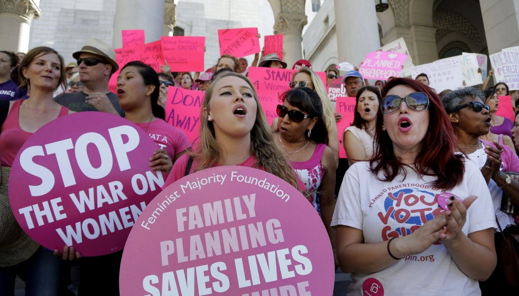 """Planned Parenthood supporters rallied at Los Angeles City Hall for women's access to reproductive health care on """"National Pink Out Day""""' on Sept. 29, 2015. (AP photo)"""
