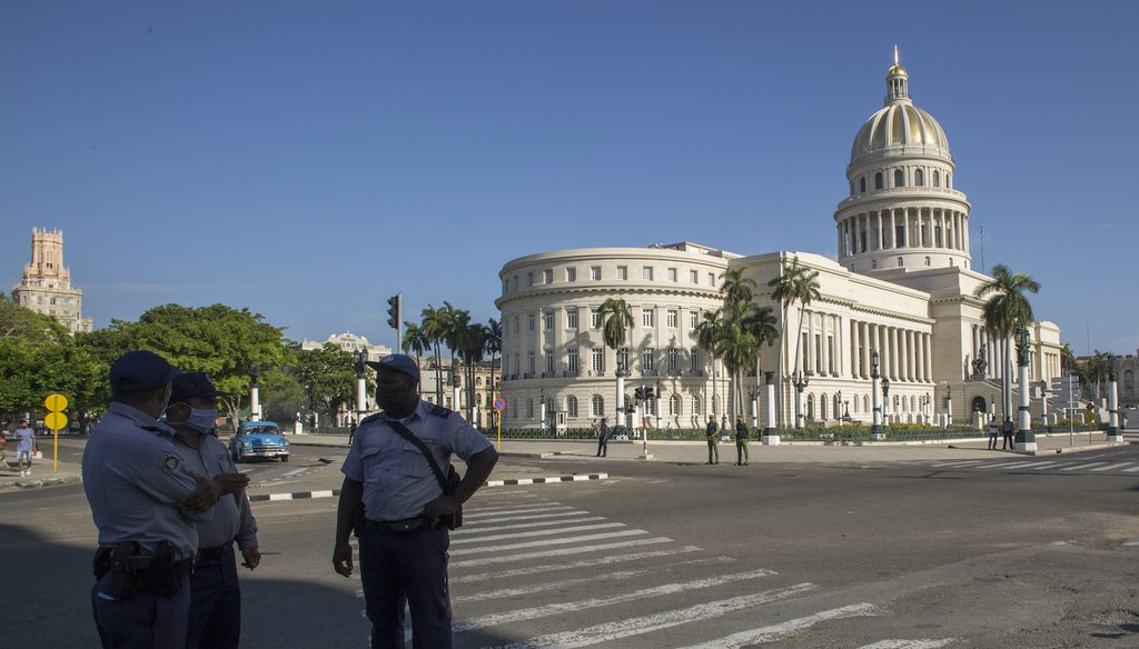 Police stand guard near the National Capitol building in Havana, Cuba, July 12, 2021 (AP)
