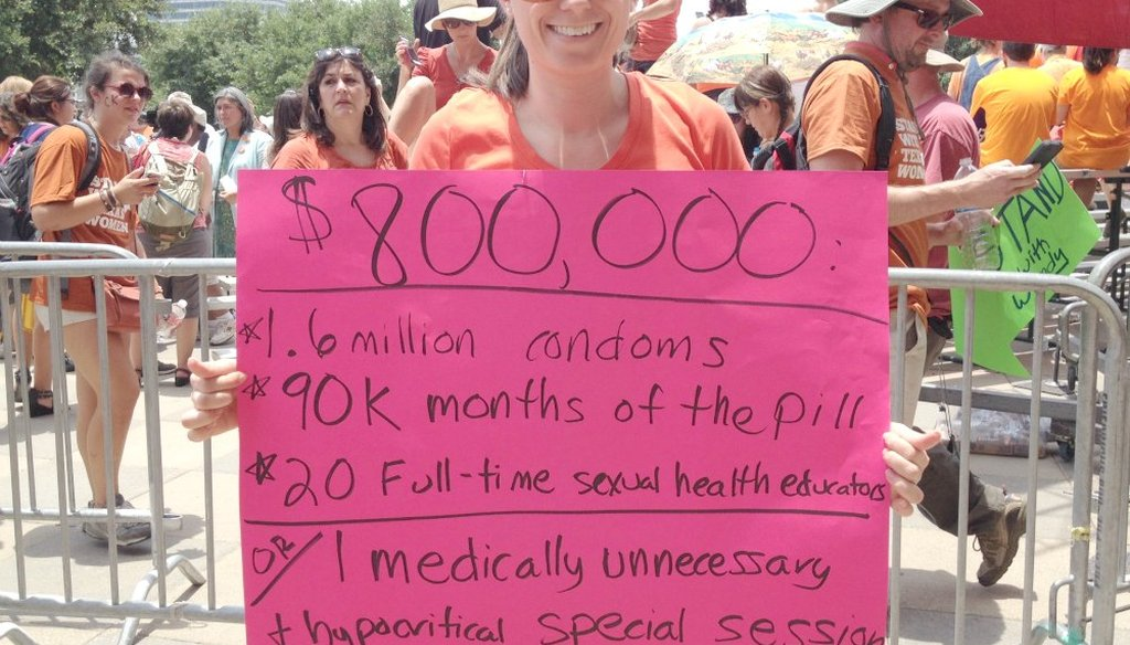 Sarah Ponder of Austin told us how she reached her estimates for the sign she carried at the July 1, 2013, rally against abortion restrictions at the state Capitol. (Sue Owen photo/Austin American-Statesman)