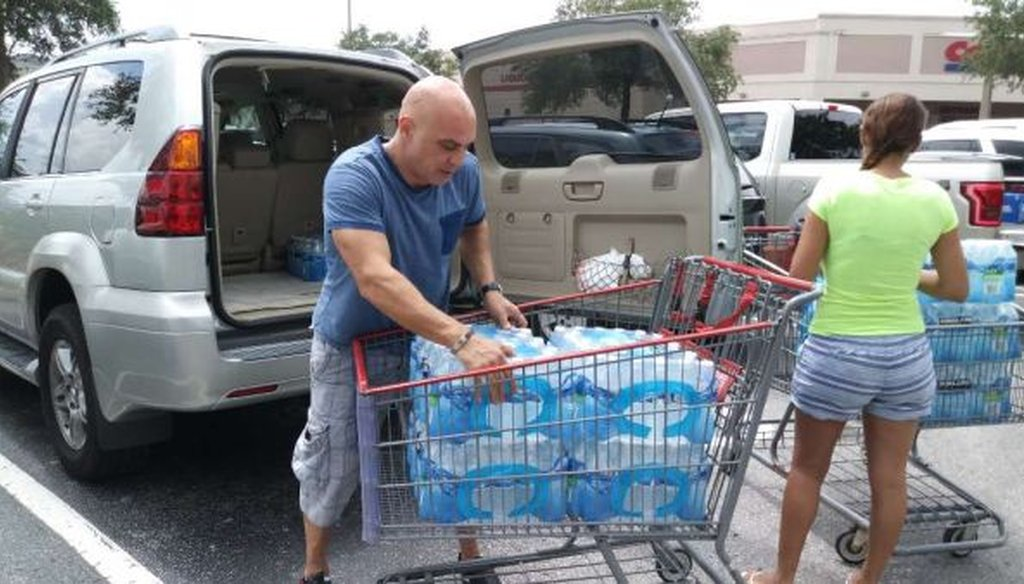 Ali Alchikh and his wife, Najoua Laroui, replenished supplies of bottled water at Costco as Hurricane Irma approached. (Jonathan Capriel/Tampa Bay Times)