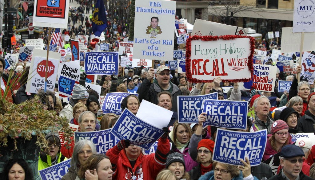 Demonstrators protesting what would become Act 10, Gov. Scott Walker's collective bargaining reform law, gathered in Madison on Nov. 19, 2011. Police estimated the crowd at 68,000 people. (Rick Wood photo)