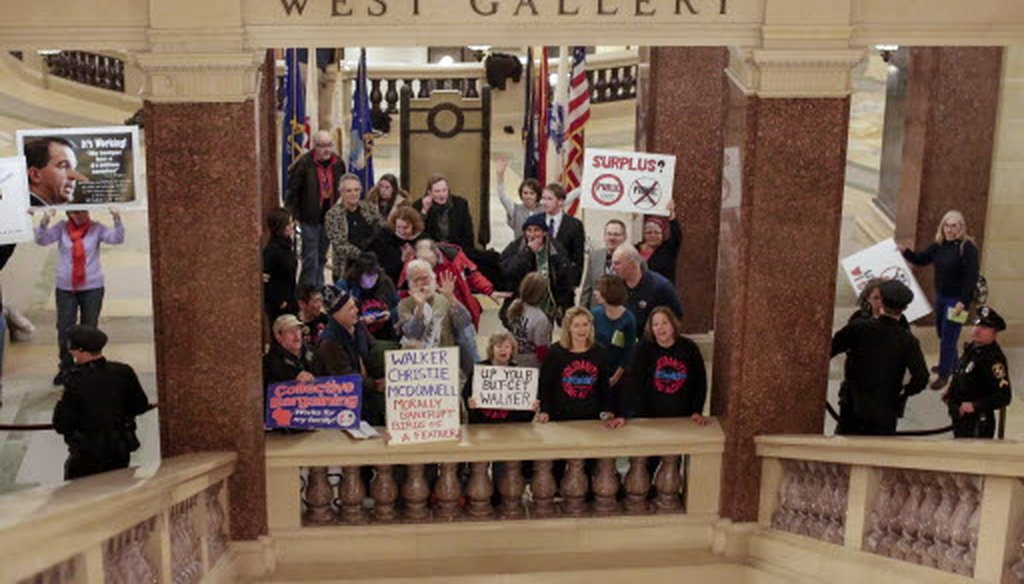 Protesters demonstrated in the Capitol during Gov. Scott Walker's State of the State address on Jan. 22, 2014.