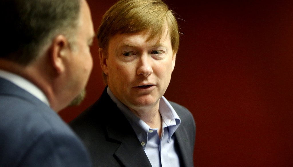 Adam Putnam, Commissioner of the Florida Department of Agriculture and Consumer Services, center, visits with Charles W. Thomas, Pinellas County Tax Collector, at the Pinellas County Courthouse on June 29, 2017. (DOUGLAS R. CLIFFORD | Times)