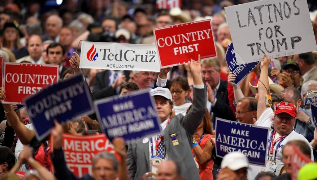A Ted Cruz supporter holds a sign during his speech on the third day of the Republican National Convention in Cleveland, Wednesday, July 20, 2016. (AP Photo/Mark J. Terrill)