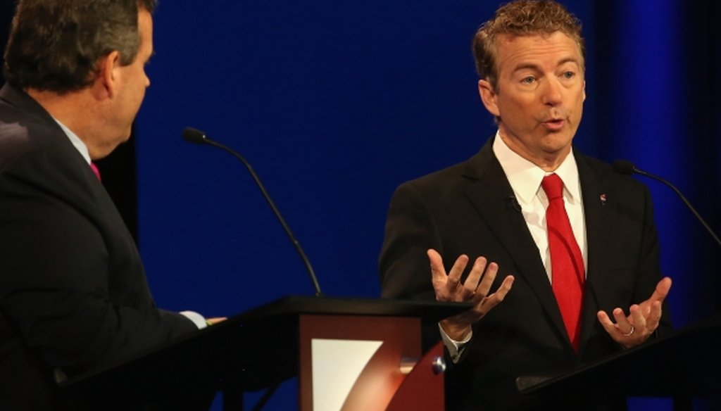 Presidential candidate Rand Paul speaks while New Jersey Gov. Chris Christie looks on during the CNBC Republican presidential debate in Boulder, Colo. (Justin Sullivan/Getty Images)