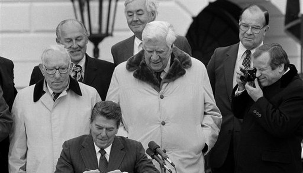 President Ronald Reagan signs the $167 billion dollar Social Security rescue plan during a ceremony on the South Lawn of the White in Washington, April 20, 1983. (AP)