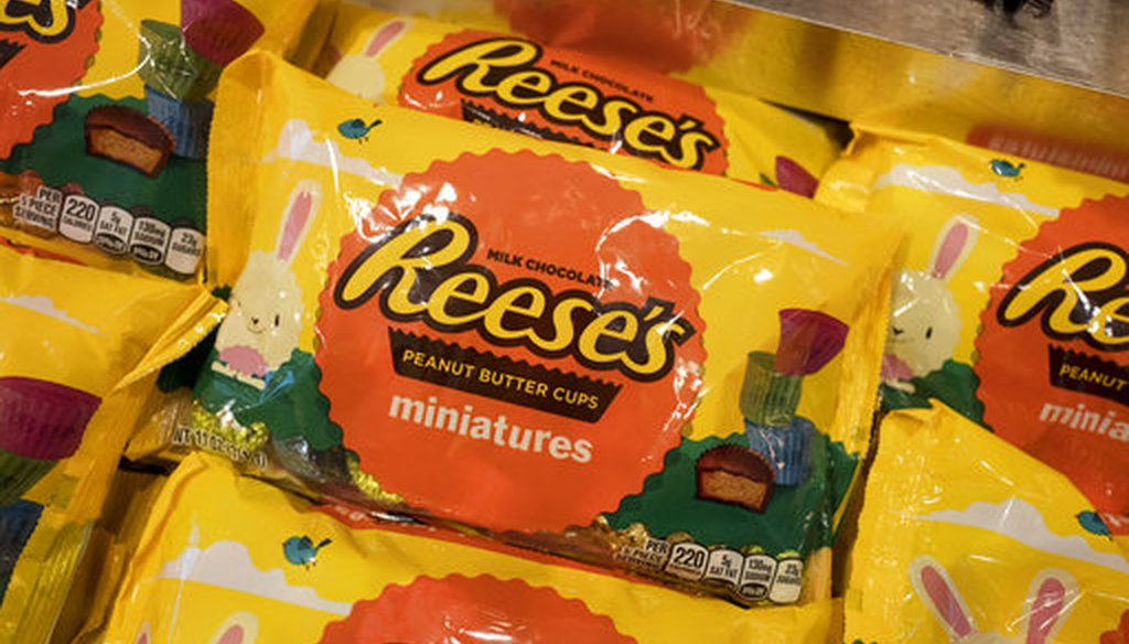In this March 1, 2017, file photo, Reese's miniature peanut butter cups are displayed in Hershey's Times Square store in New York. Hershey's told the AP in September that a story claiming the company would discontinue the Reese's candy is false. (AP)