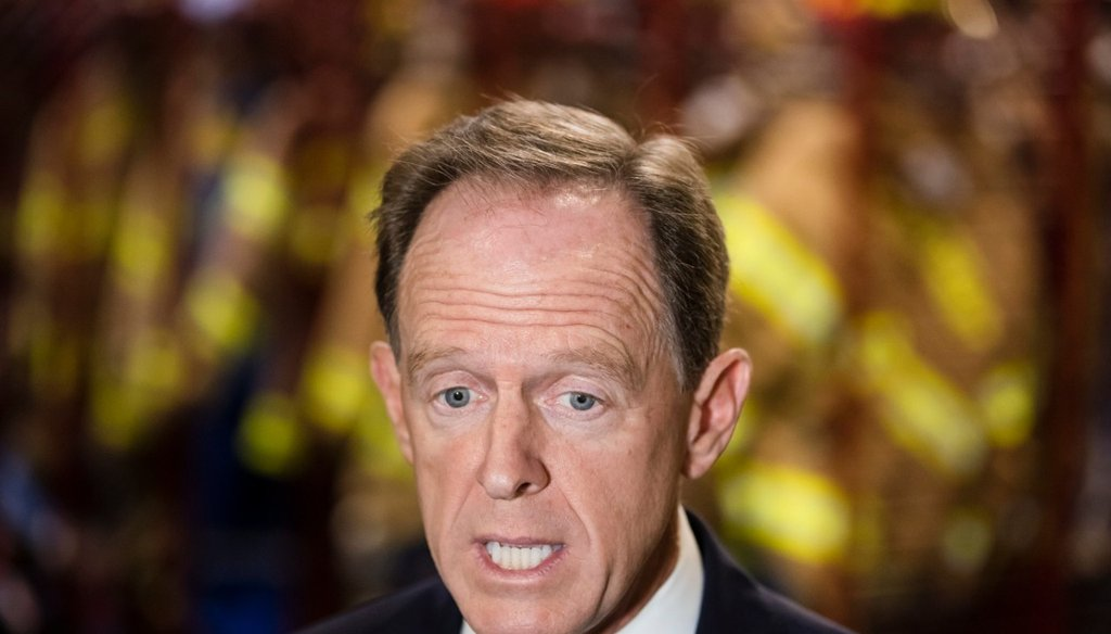 Sen. Pat Toomey, R-Pa., speaks speaks with members of the media at the Monroe Energy Trainer Refinery in Trainer, Pa., Monday, July 29, 2019. (AP Photo/Matt Rourke)