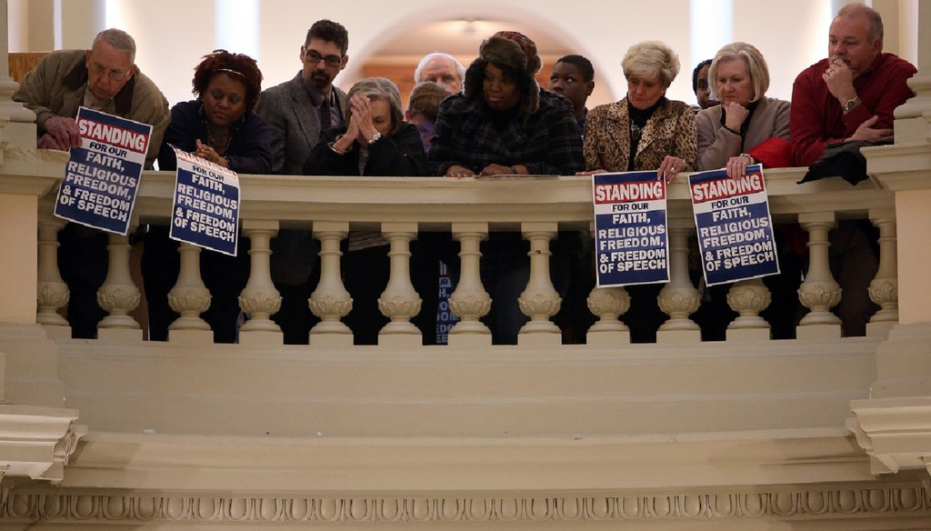 A crowd lines the railings above the Capitol Rotunda during a rally for former Atlanta Fire Chief Kelvin Cochran, whose firing has energized supporters of a proposed religious liberty bill. Photo by Ben Gray / AJC.COM