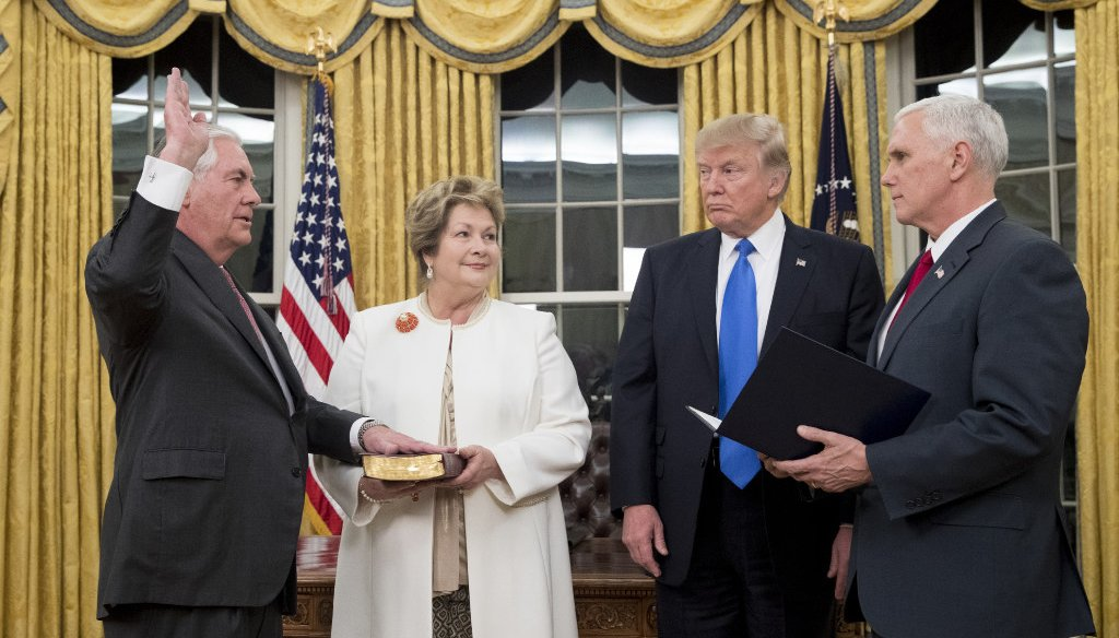 Rex Tillerson (left) is sworn in as secretary of state by Vice President Mike Pence on Feb. 1, 2017, as Tillerson's wife, Renda St. Clair, and President Donald Trump look on. (Getty Images)