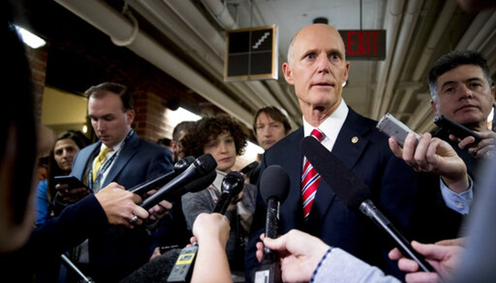 Sen. Rick Scott, R-Fla., speaks to reporters outside his office on Capitol Hill in Washington, Wednesday, Jan. 23, 2019. Scott took questions on Venezuela and the government shutdown. (AP)