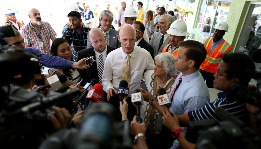 "Gov. Rick Scott denied reports that state banned the term ""climate change"""