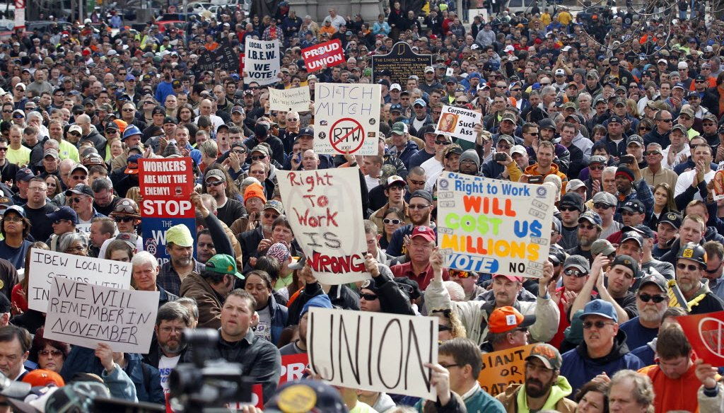 Protesters gathered outside the Indiana Statehouse after the state Senate voted to pass a right to work bill on Feb. 1, 2012. The measure became law and was upheld by the Indiana Supreme Court in November 2014. (AP photo)