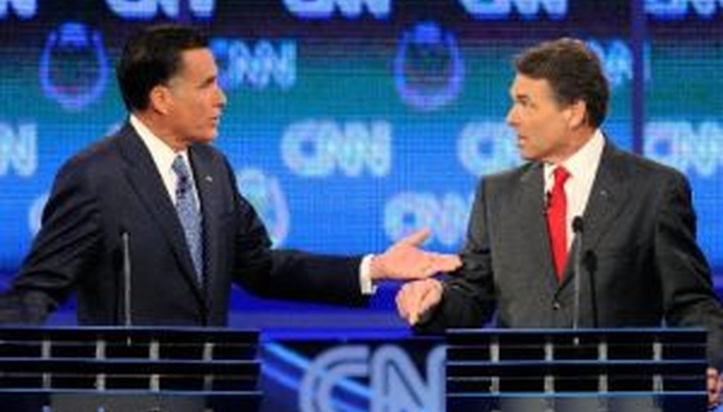 Former Massachusetts Gov. Mitt Romney and Texas Gov. Rick Perry gesticulate during the Oct. 18, 2011, Republican presidential debate in Las Vegas.