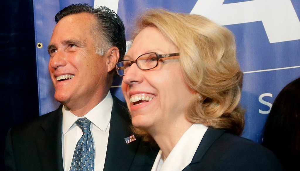 """2012 Republican presidential candidate Mitt Romney stands with Michigan Senate candidate Terri Lynn Land in Livonia, Mich., Oct. 2, 2014. In 2012, Land said she was """"with (Romney)"""" in his opposition to the strategy for the federal auto bailout."""