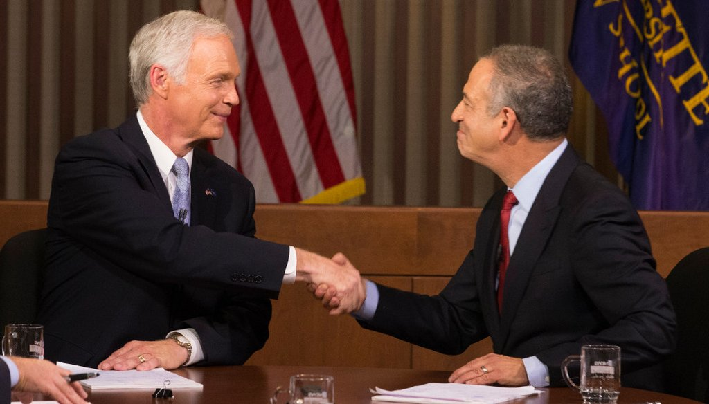 Republican U.S. Sen. Ron Johnson (left) and his Democratic challenger, Russ Feingold, shake hands after their debate in Milwaukee on Oct. 18, 2016. (Milwaukee Journal Sentinel photo by Mark Hoffman)