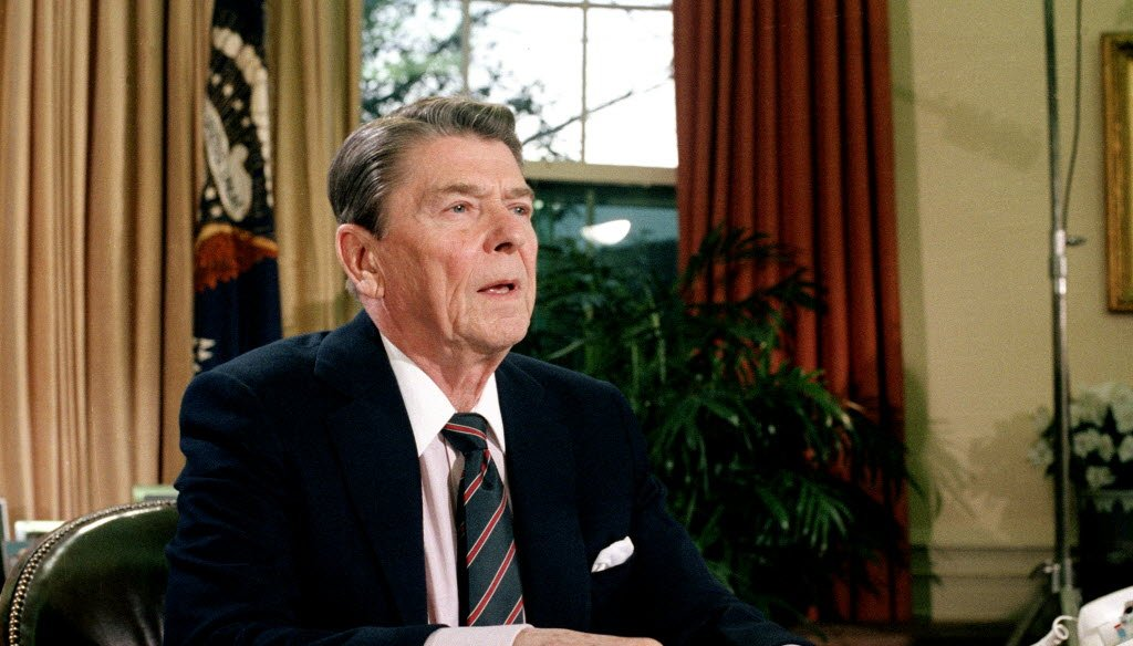 President Ronald Reagan, shown here in January 1986, signed landmark tax reform legislation in October 1986. Comparisons to that legislation are being made to tax bills now before Congress. (Associated Press)