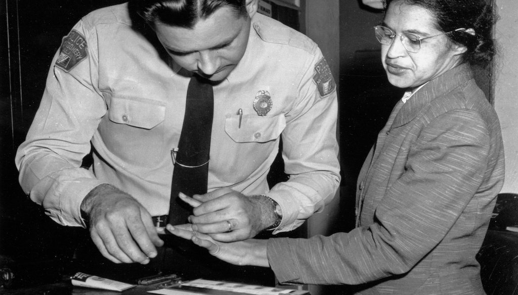 On Feb. 22, 1956, Rosa Parks was fingerprinted by police Lt. D.H. Lackey in Montgomery, Ala., two months after refusing to give up her seat on a bus for a white passenger on Dec. 1, 1955. (AP Photo/Gene Herrick, File)
