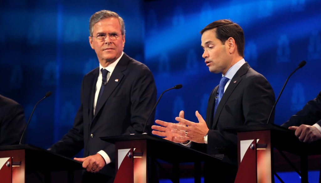 Florida Sen. Marco Rubio answers a question at the third GOP debate as former Florida Gov. Jeb Bush looks on. (NYT)
