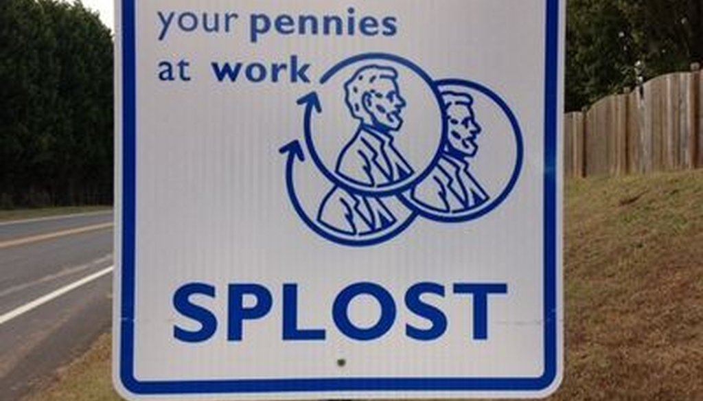 This sign marks a road project funded by Gwinnett County's Special Purpose Local Option Sales Tax. Photo credit: WSB.