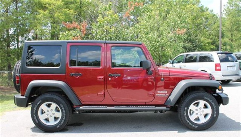 A 2012 Jeep Wrangler Unlimited Sport SUV.