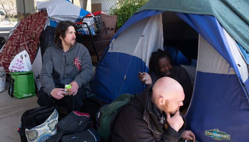 Residents at a homeless encampment in Sacramento in March 2020.  Andrew Nixon / CapRadio