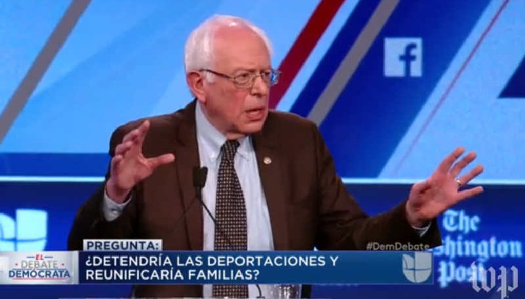 At the Democratic presidential debate in Miami, Vermont Sen. Bernie Sanders accused Hillary Clinton of supporting harsh policies toward immigrants. (screenshot)