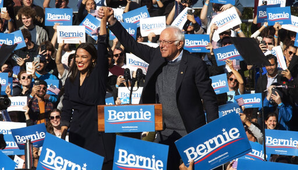 Democratic presidential candidate Sen. Bernie Sanders, I-Vt., right, is introduced by Rep. Alexandria Ocasio-Cortez, D-N.Y., during a campaign rally in New York City. (AP Photo/Mary Altaffer)