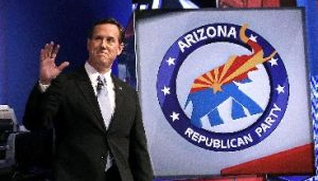 Rick Santorum waves to the crowd as he is introduced at the start of a Republican presidential debate on Feb. 22, 2012, in Mesa, Ariz.