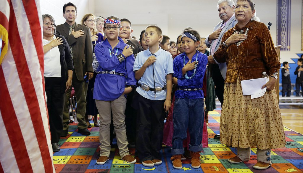 """In this Sept. 26, 2014 file photo, students and faculty recite the """"Pledge of Allegiance"""" during an assembly at the Crystal Boarding School in Crystal, N.M., on the Navajo Nation. (AP)"""