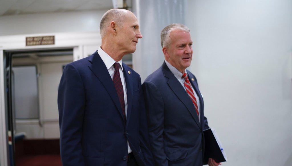 Sen. Rick Scott, R-Fla., left, and Sen. Dan Sullivan, R-Alaska, arrive for votes on amendments to advance the $1 trillion bipartisan infrastructure bill at the Capitol. (AP Photo/J. Scott Applewhite)