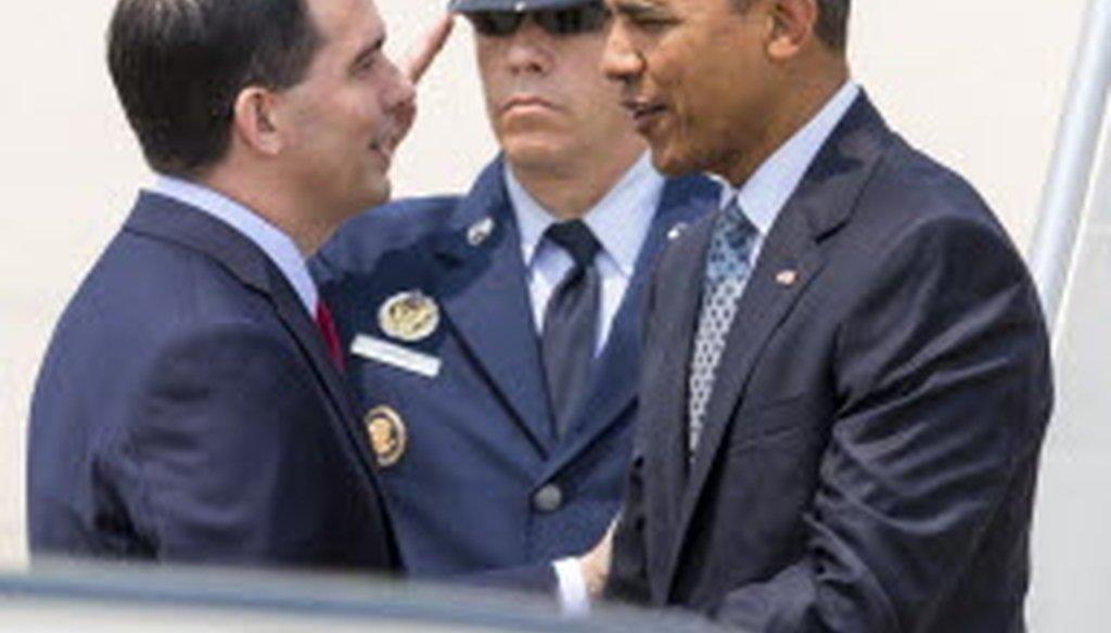 Gov. Scott Walker greeted President Barack Obama when Obama arrived at an airport in La Crosse, Wis., on July 2, 2015. (AP photo)