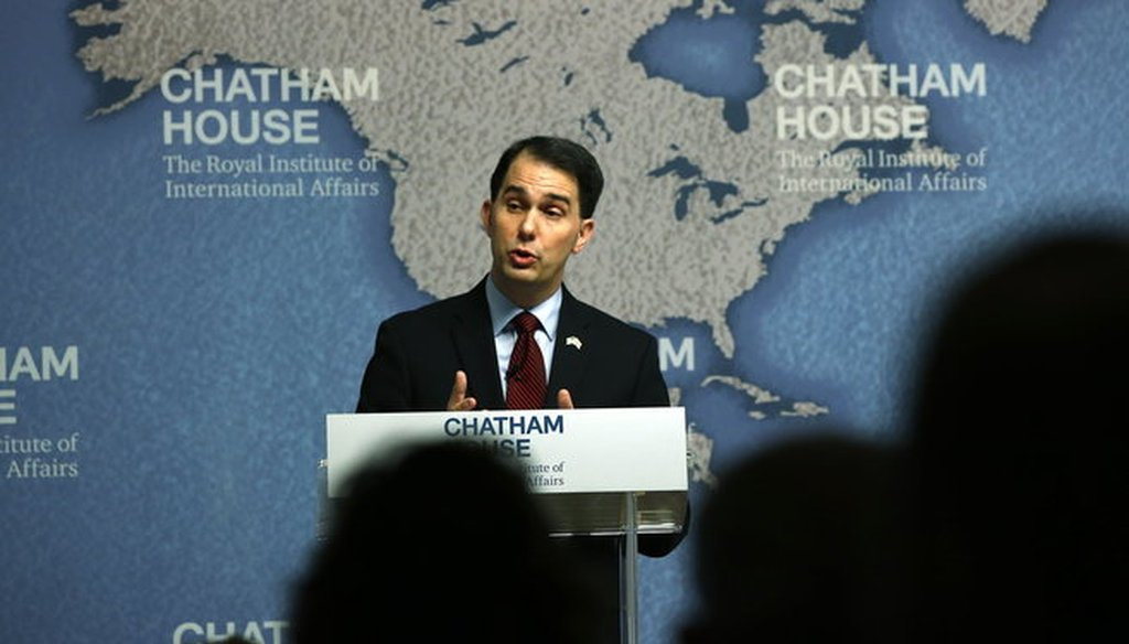 Gov. Scott Walker, shown here speaking at Chatham House in London on Feb. 11, 2015, was a central figure in out most-clicked items that month. (AP photo)