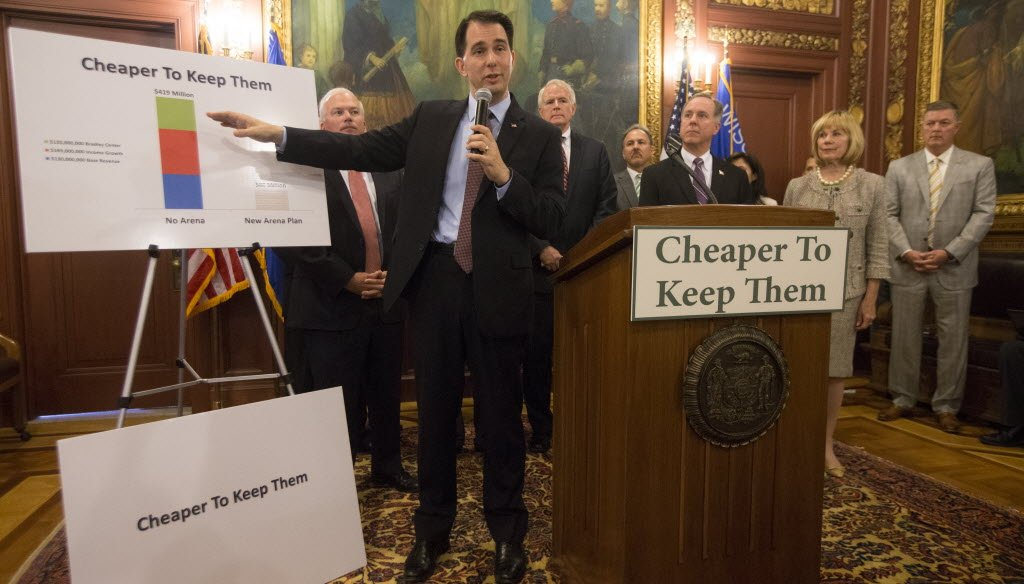 At a Capitol news conference on June 4, 2015, Gov. Scott Walker announced new details of a proposal to build a new arena for the Milwaukee Bucks and a slogan aimed at persuading lawmakers and taxpayers to support the deal.