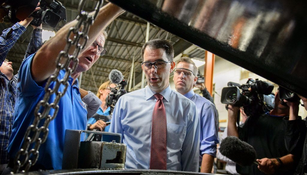 Campaigning for president, Wisconsin Gov. Scott Walker toured Cass Screw Machine in Brooklyn Center, Minn. on Aug. 18, 2015 and announced his plan to replace Obamacare. (AP photo)