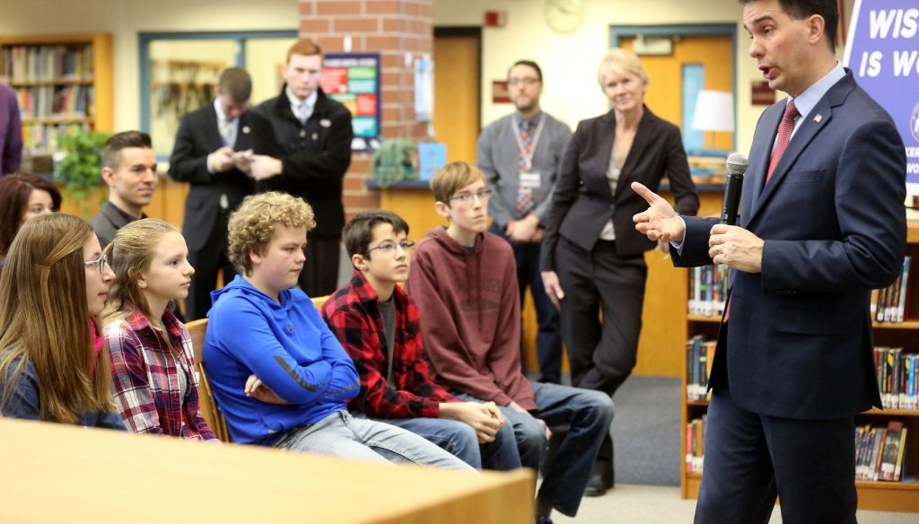 "Gov. Scott Walker, appearing here at a middle school in Platteville in February 2017, is criticized for cutting aid to schools but nevertheless claims he has made a ""record investment"" in them. (Associated Press)"