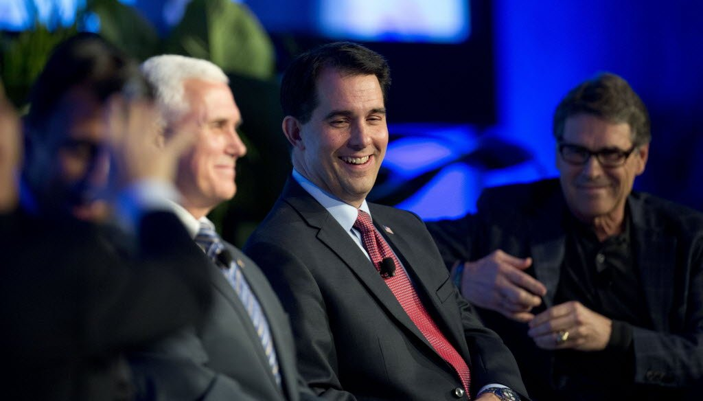 Talk of Wisconsin Gov. Scott Walker running for president grew during the annual meetings of the Republican Governors Association in November 2014. Walker is shown with GOP Governors Mike Pence of Indiana (left) and Texas Gov. Rick Perry. (AP photo)