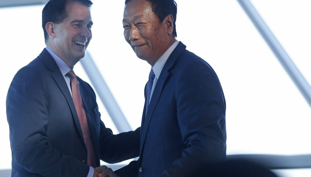Wisconsin Gov. Scott Walker (left) and Foxconn chairman Terry Gou have struck a multi-billion deal to bring a manufacturing plant to Wisconsin. Some question whether the state is offering too much in incentives. (Mike De Sisti/Milwaukee Journal Sentinel)