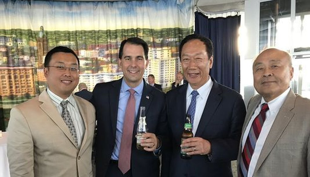 Will Hsu (from left), Gov. Scott Walker, Foxconn chairman Terry Gou and Hsu's father, Paul Hsu, posed for a photo when Walker and Gou signed an agreement in which Foxconn says it will build a manufacturing plant in Wisconsin. (Courtesy Will Hsu)
