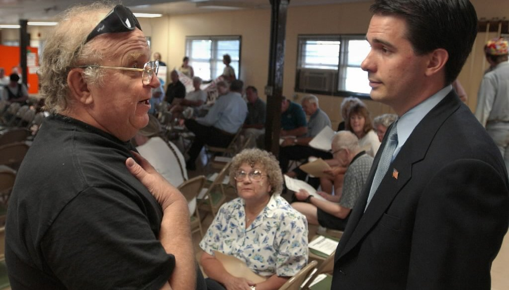 Wisconsin Gov. Scott Walker (right) was the Milwaukee County executive when he chatted with a constituent during a county budget hearing in 2002. (Milwaukee Journal Sentinel)