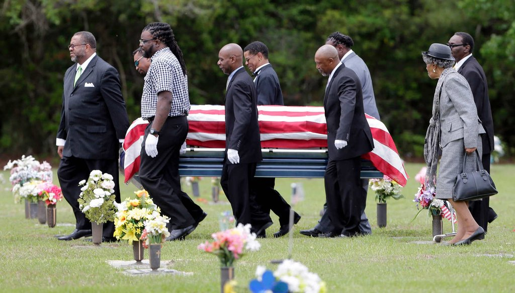 Pallbearers walk Walter Scott's casket to the gravesite for his burial service in Charleston, S.C. on Saturday, April 11, 2015. Scott's death at the hands of a North Charleston, S.C., police officer reignited calls for more police accountability. (AP)