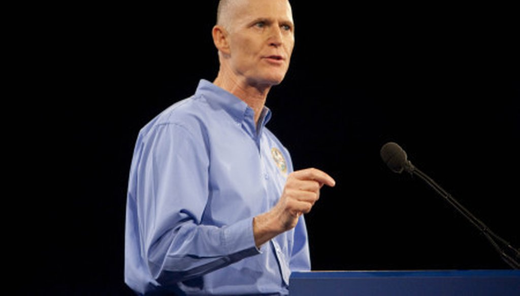 Florida Gov. Rick Scott delivers the keynote address at Florida's Presidency 5 meeting.