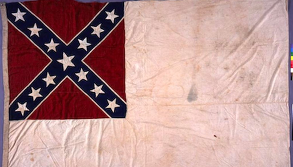 "This photo from the Texas State Library and Archives shows the ""Stainless Banner,"" the second national flag of the Confederacy, which incorporates the the battle flag most Americans today think of as the Confederate flag."