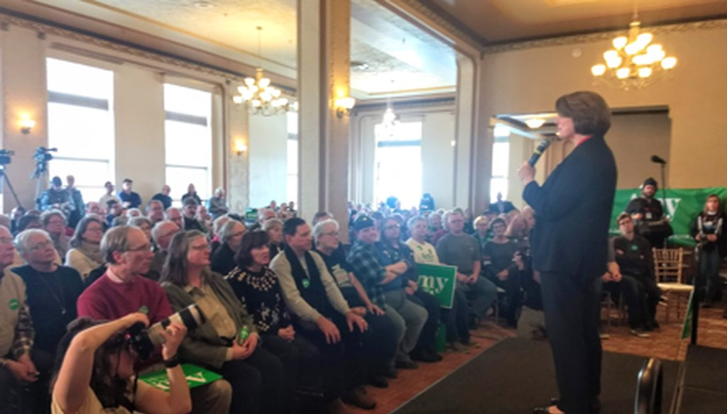 Amy Klobuchar takes questions from a near-capacity crowd in Waterloo, Iowa. (Louis Jacobson/PolitiFact)