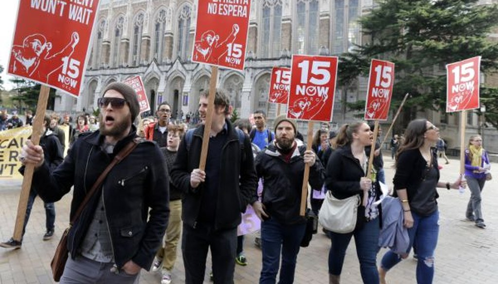 Students and other supporters protest on the University of Washington campus in Seattle in support of raising the minimum wage for campus workers to $15 an hour on April 1, 2015. (AP/Ted S. Warren)